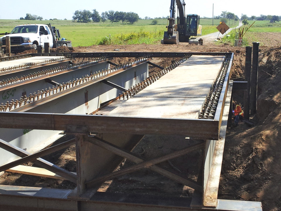 Photo - A McClain County bridge near Washington, OK, that was built using steel beams from the old Interstate 40 Crosstown Expressway is shown under construction.   Photo Provided - PHOTO PROVIDED