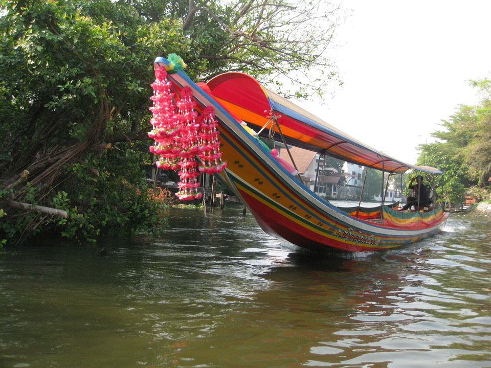 Photo -  Taking a traditional dragon boat is the best way to see the klongs in Bangkok, Thailand. Photo courtesy of Barbara Selwitz.