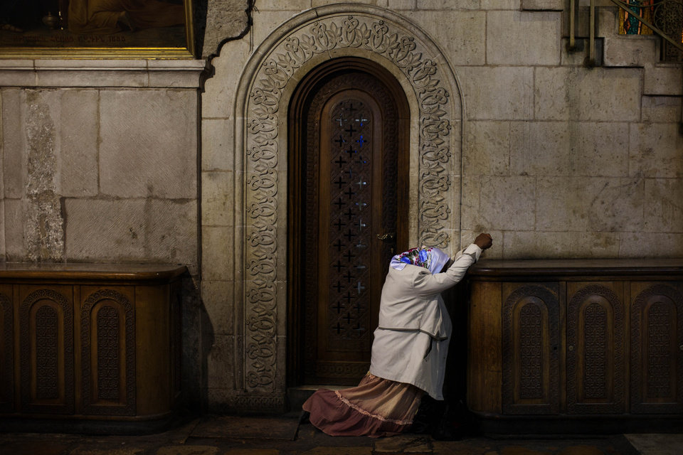 A christian pilgrim prays inside the Church of the Holy Sepulchre, traditionally believed to be the burial site of Jesus Christ, in Jerusalem's Old City, during the Easter Holy Week, Thursday, April 5, 2012. (AP Photo/Bernat Armangue)
