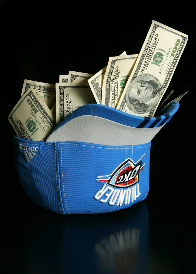 Photo - MONEY / ONE HUNDRED DOLLAR BILLS: Photo illustration on the Oklahoma City Thunder's salary cap in Oklahoma City, Oklahoma February 5 , 2009.  BY STEVE GOOCH, THE  OKLAHOMAN. ORG XMIT: KOD