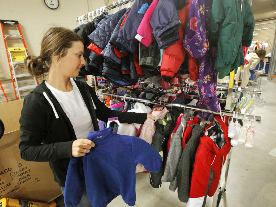 Laura Maggard, a University of Central Oklahoma freshman from Moore, sorts clothes Monday during a volunteer day at Infant Crisis Services, in Oklahoma City. PHOTO BY PAUL B. SOUTHERLAND, THE OKLAHOMAN