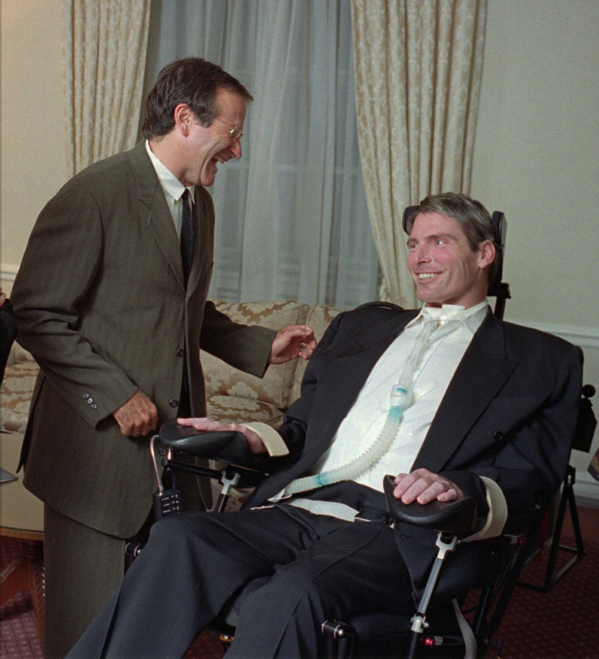 Photo - Comedian Robin Williams, left, greets Christopher Reeve prior to The Creative Coalition's annual Spotlight Awards Dinner at The Pierre hotel in New York Monday, Oct. 16, 1995. This is Reeve's first public appearance since his equestrian accident last May. (AP Photo/Arthur Grace/Sygma)