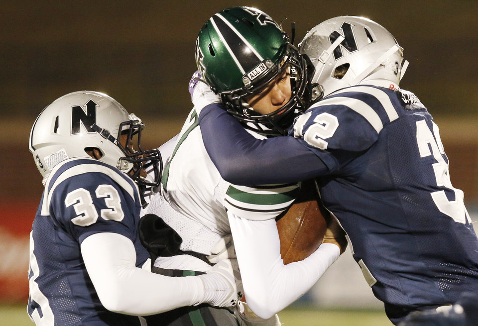 EN#33 Alex Burt, left, and EN#32 Joel Dixon, right, make a sandwich of NN#7 John Kolar during the high school football game between Norman North and Edmond North in Edmond at Wantland Stadium Friday, Friday, October 18, 2013.  Photo by Doug Hoke, The Oklahoman