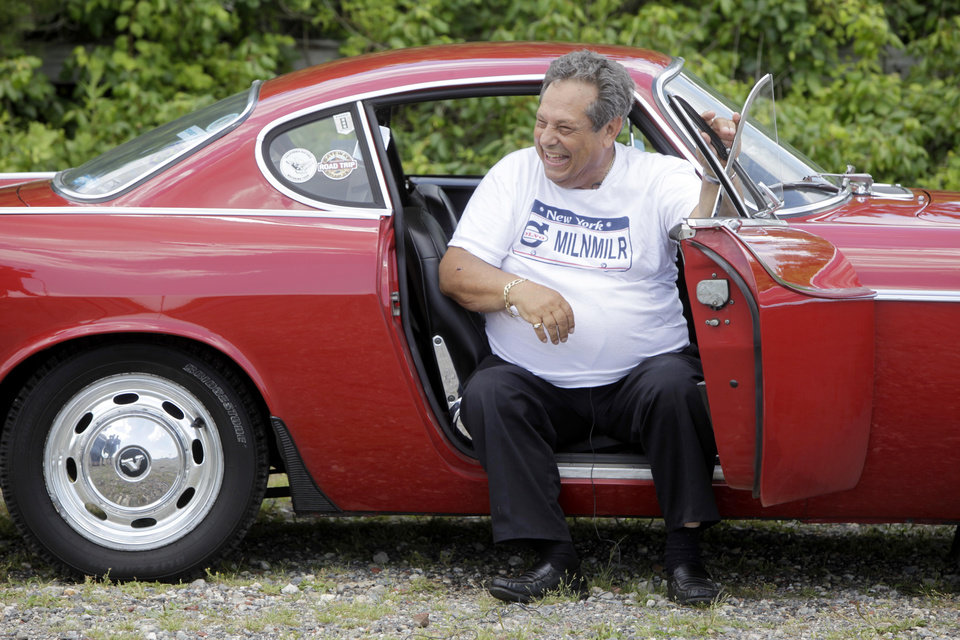 Photo -   Irv Gordon laughs while being interviewed in his Volvo P1800 in Babylon, N.Y., Monday, July 2, 2012. Gordon's car already holds the world record for the highest recorded milage on a car and he is less than 40,000 miles away from passing three million miles on the Volvo. (AP Photo/Seth Wenig)
