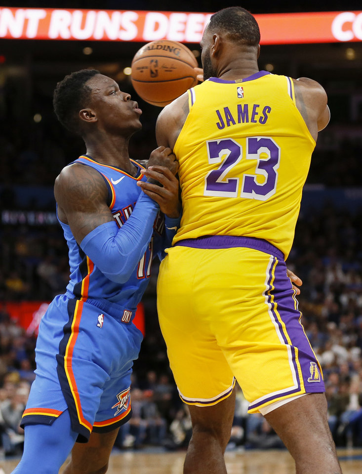 Photo - Los Angeles' LeBron James (23) passes away from Oklahoma City's Dennis Schroder (17) in the fourth quarter during an NBA basketball game between the Oklahoma City Thunder and the Los Angeles Lakers at Chesapeake Energy Arena in Oklahoma City, Friday, Nov. 22, 2019. The Lakers won 130-127. [Nate Billings/The Oklahoman]
