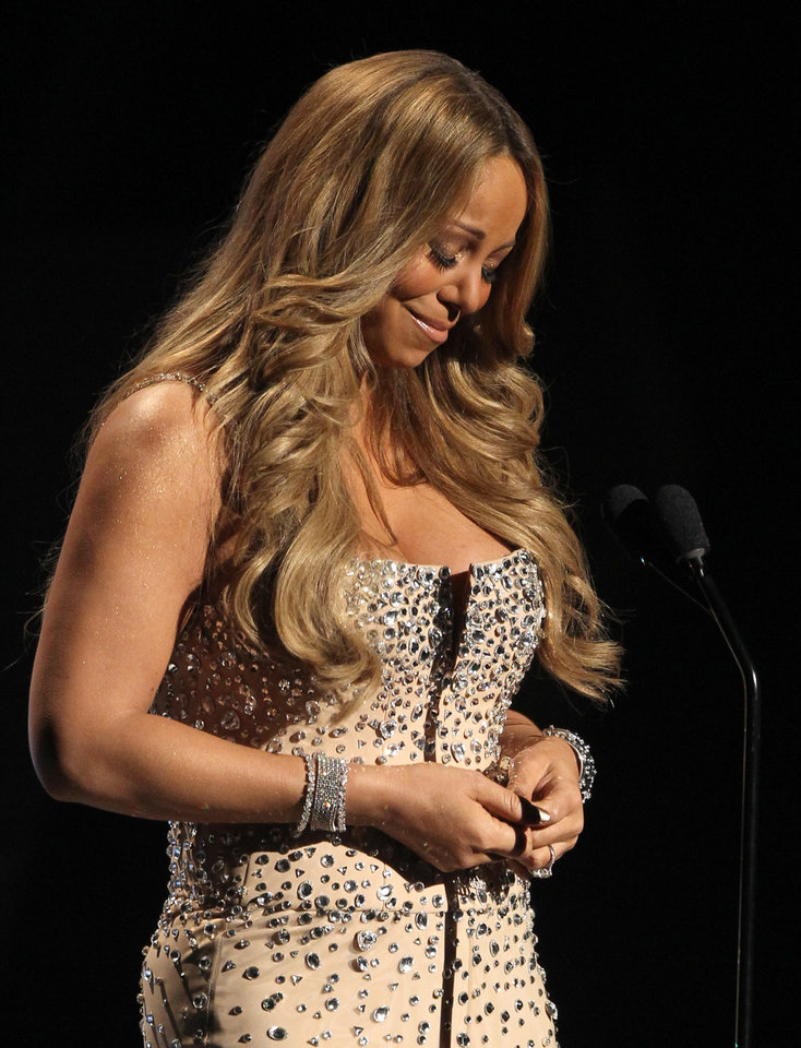 Photo -   Mariah Carey pauses as makes an address during the in memoriam to Whitney Houston at the BET Awards on Sunday, July 1, 2012, in Los Angeles. (Photo by Matt Sayles/Invision/AP)