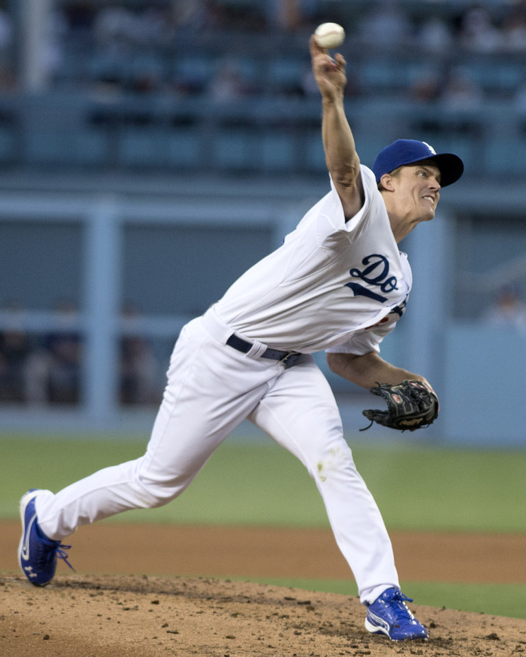 Photo - Dodgers' Zack Greinke delivers a pitch during a game against the Rockies at Dodger Stadium on Tuesday June 17, 2014. (AP Photo/The Orange County Register, Kyusung Gong)