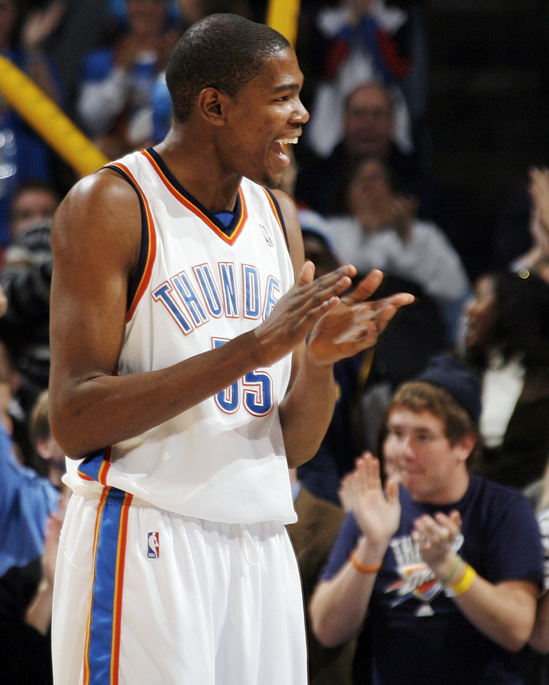 Photo - Kevin Durant (35) of Oklahoma City claps after a basket by a teammate during the NBA basketball game between the Oklahoma City Thunder and the Denver Nuggets at the Ford Center in Oklahoma City, Friday, January 29, 2010. Oklahoma City won, 101-84. Photo by Nate Billings, The Oklahoman ORG XMIT: KOD