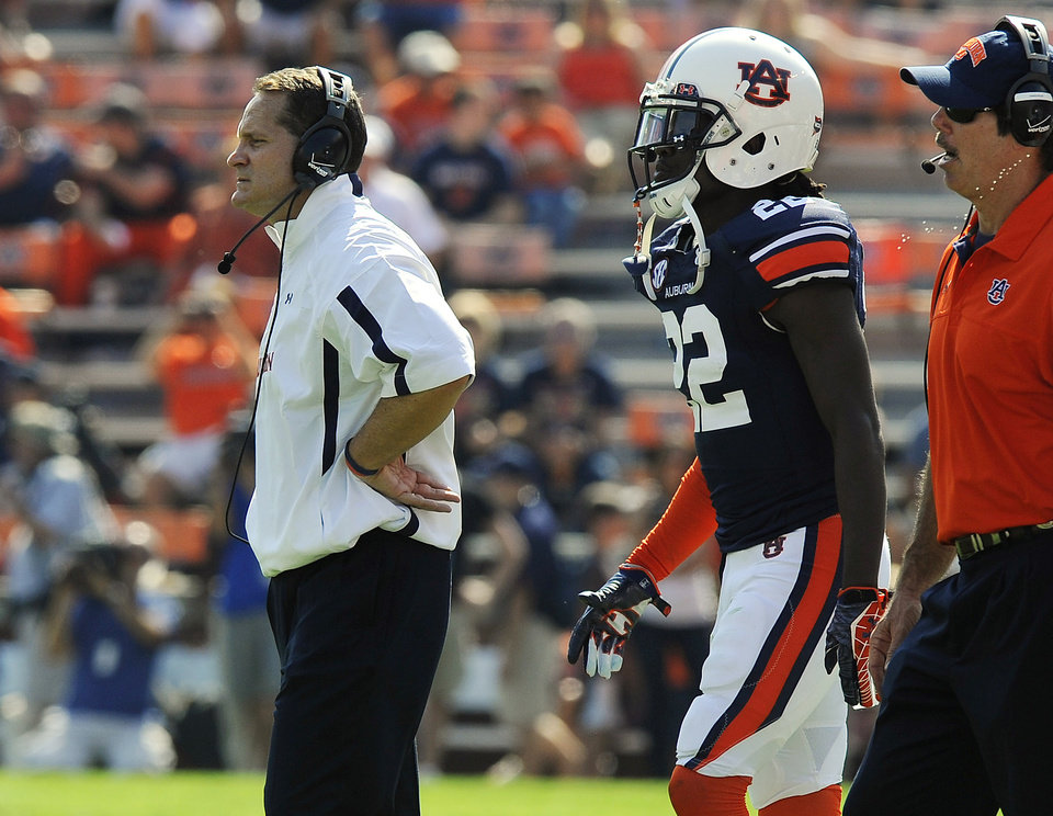 Auburn coach Gene Chizik, left, watches his defense during the second half of an NCAA college football game against Arkansas on Saturday, Oct. 6, 2012 in Auburn, Ala.(AP Photo/Todd J. Van Emst)