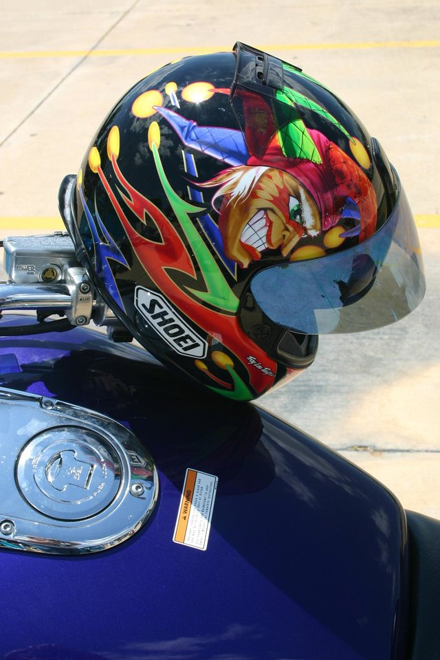 In the biker�s world custom artwork isn�t limited to motorcycles, but extends to the safety helmets that many bikers wear. This joker�s helmet is just an example of the artwork that could be seen during the J. D. McCarty Center Poker Run held Saturday, July 22. The poker run was a 180-mile tour of south central Oklahoma that started at the McCarty Center and ended at the Santa Fe Cattle Company in Norman.<br/><b>Community Photo By:</b> Greg Gaston<br/><b>Submitted By:</b> Greg,