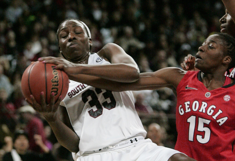 Photo - South Carolina's Elem Ibiam (33) tries to keep a rebound from Georgia's Krista Conald (15) during the first half of an NCAA college basketball game Thursday, Feb. 27, 2014, in Columbia, S.C. (AP Photo/Mary Ann Chastain)