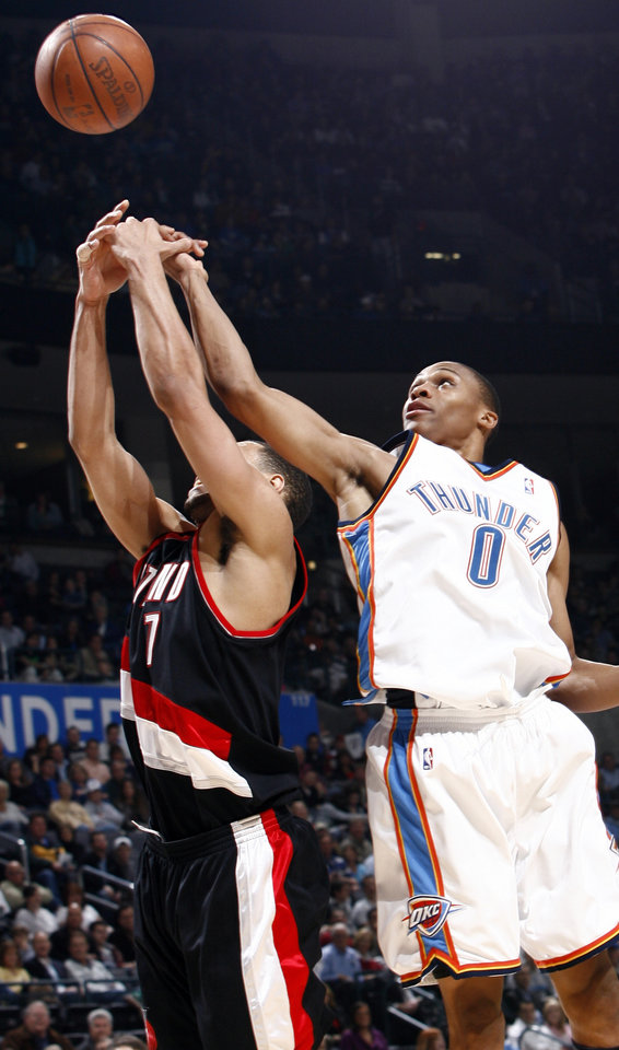 Photo - Portland's Brandon Roy (7) and Oklahoma City's Russell Westbrook (0) try to rebound the ball during the NBA basketball game between the Oklahoma City Thunder and the Portland Trail Blazers at the Ford Center in Oklahoma City, Friday, February 6, 2009. BY NATE BILLINGS, THE OKLAHOMAN