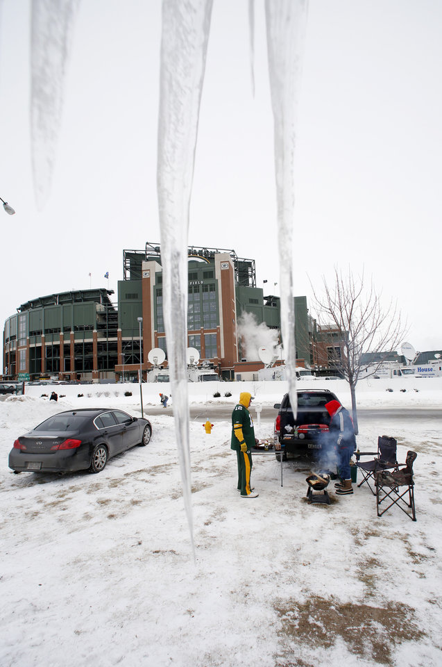 Photo - Icicles are seen outside Lambeau Field as fans tailgate before an NFL wild-card playoff football game between the Green Bay Packers and the San Francisco 49ers, Sunday, Jan. 5, 2014, in Green Bay, Wis. (AP Photo/Jeffrey Phelps)