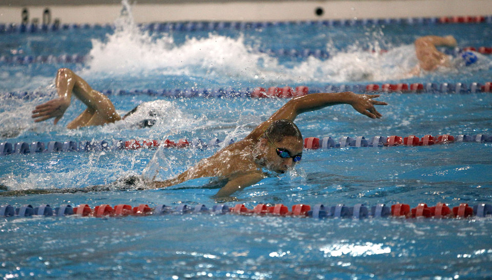 Edmond Memorial\'s Naresh Naik swims in the Boys 100-yard freestyle during the 6A state championship swim meet at Oklahoma City Community College, Saturday, Feb. 18, 2012. Photo by Sarah Phipps, The Oklahoman