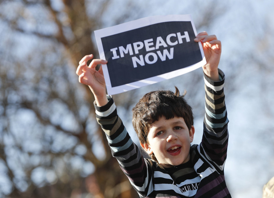 "Photo - Marcel Ast, 10, from New Jersey, holds up a sign during a ""Not My Presidents Day"" rally at DuPont Circle in Washington, Monday, Feb. 20, 2017. Anti-President Donald Trump activists seized on Monday's federal holiday to organize rallies in cities around the country to oppose policies by Trump. (AP Photo/Pablo Martinez Monsivais)"