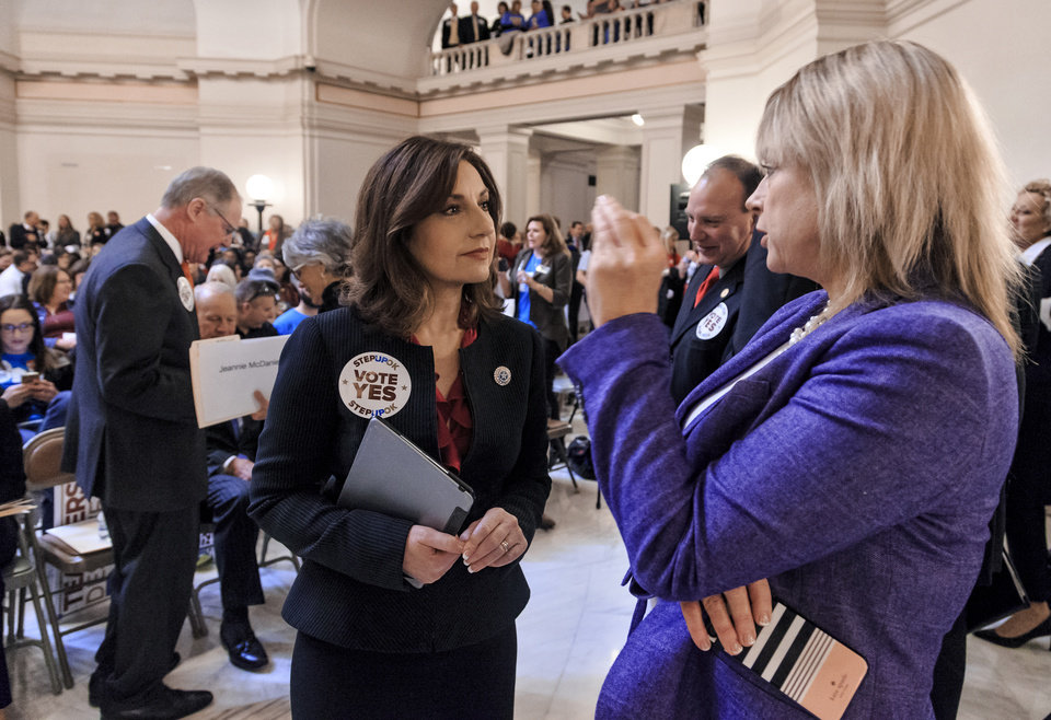 Photo - Oklahoma State Superintendent Joy Hofmeister, left, speaks with Representative Leslie Osborn during a rally to support the Step Up Oklahoma Plan at the state capitol in Oklahoma City, Okla. on Monday, Feb. 12, 2018.    Photo by Chris Landsberger, The Oklahoman