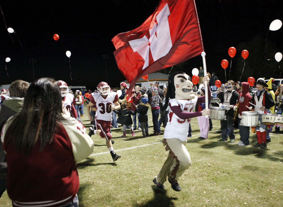 Wynnewood Savage mascot leads the team onto the field to play Wayne in high school Football on Friday, Oct. 26, 2012 in Wayne, Okla.  Photo by Steve Sisney, The Oklahoman