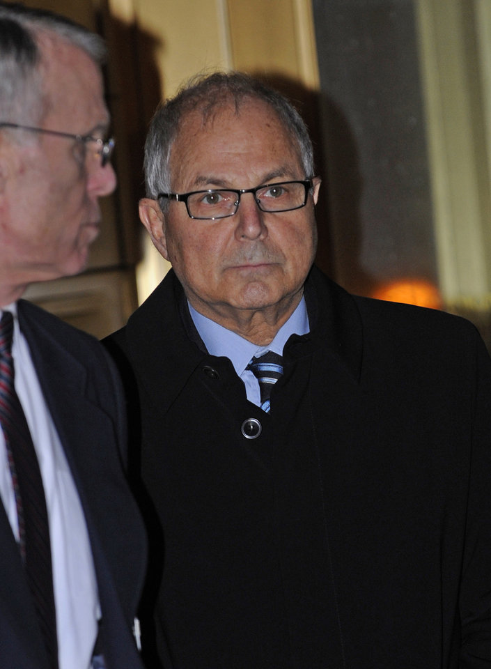 Photo - Peter Madoff exits Manhattan federal court after receiving his sentence, Thursday, Dec. 20, 2012, in New York. The brother of imprisoned financier Bernard Madoff was sentenced Thursday to 10 years in prison for crimes committed in the shadow of his notorious sibling by a judge who said she disbelieved his claims that he did not know about the epic fraud. (AP Photo/Louis Lanzano)