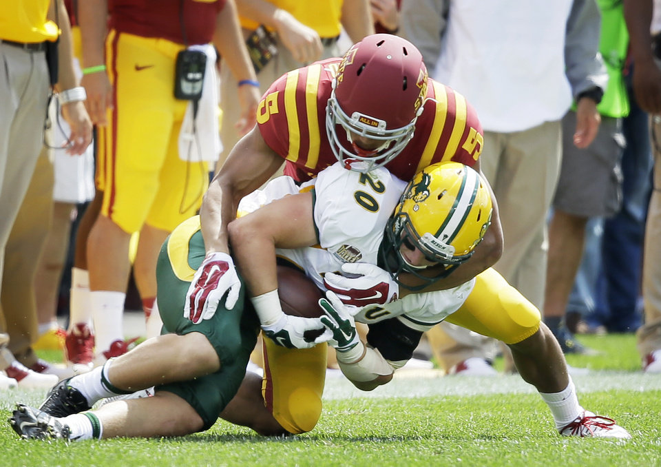 Photo - North Dakota State safety Colten Heagle (20) intercepts a pass in front of Iowa State wide receiver Allen Lazard during the second half of an NCAA college football game, Saturday, Aug. 30, 2014, in Ames, Iowa. North Dakota State won 34-14. (AP Photo/Charlie Neibergall)