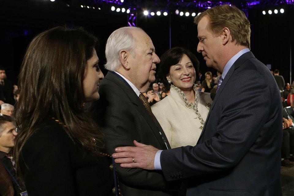 NFL Commissioner Roger Goodell, right, greets New Orleans Saints owner Tom Benson as Benson's wife Gayle, and daughter Rita Benson LaBlanc, left, look on before an NFL Super Bowl XLVII football game news conference at the New Orleans Convention Center, Friday, Feb. 1, 2013. in New Orleans. (AP Photo/Gerald Herbert)