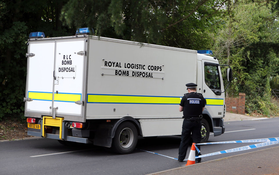 Photo -   A Royal Logistic Corps bomb disposal truck close to the home of Saad al-Hilli, in Claygate, England, who was shot dead with three others while vacationing in the French Alps, Monday Sept. 10, 2012. UK police say they have evacuated homes near the house of a British-Iraqi couple slain while vacationing in the French Alps because of concerns about items found at the property. (AP Photo/PA, Steve Parsons) UNITED KINGDOM OUT NO SALES NO ARCHIVE