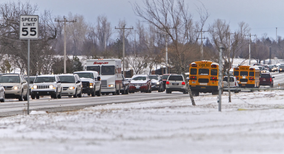 Photo - Traffic backs up on northbound Mustang Road as drivers take it slow on their way to work after snow hit the metro area on Monday, Feb. 13, 2012, in Yukon, Okla. Photo by Chris Landsberger, The Oklahoman