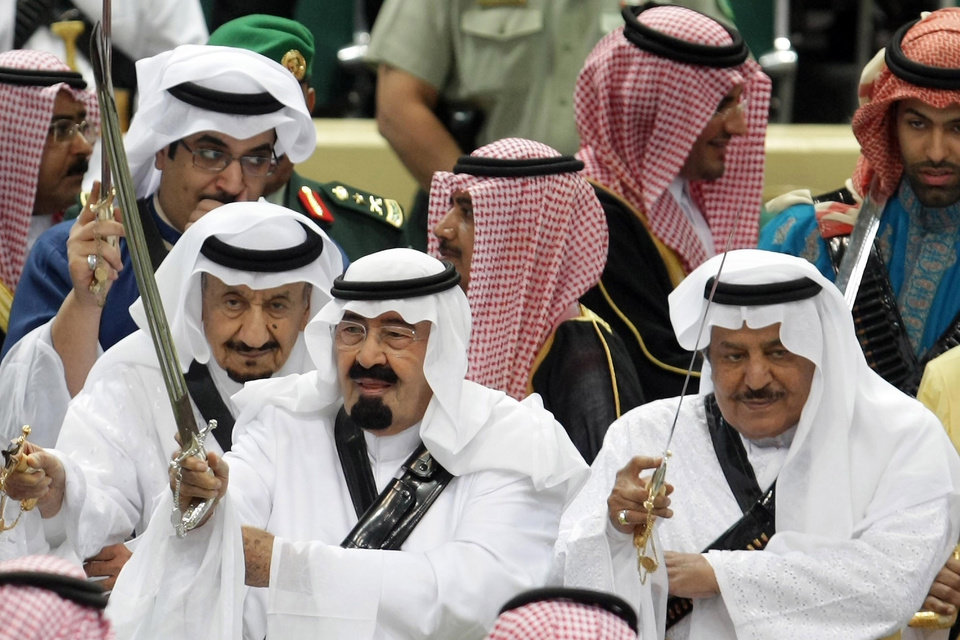 Photo - FILE - In this Tuesday, March 23, 2010 file photo, King Abdullah, center, of Saudi Arabia and his half brother Saudi Interior Minister Prince Nayef bin Abdul Aziz al-Saud, right, hold their swords as they take part in the traditional Arda dance, or War dance, during the Janadriyah Festival of Heritage and Culture on the outskirts of Riyadh, Saudi Arabia. King Abdullah has ratified a new counter-terrorism law which went into effect Sunday, Feb. 2, 2014. Rights activists said that the law criminalizes speech critical of the government or society. It was published in full in the government's official gazette Um Al-Qura Friday. (AP Photo, File)