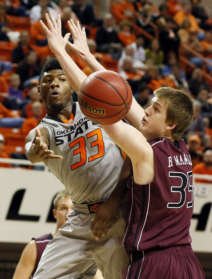 Photo - OSU's Marcus Smart (33) passes the ball around Bruce Marshall (35) of Missouri State during a men's college basketball between Oklahoma State University and Missouri State at Gallagher-Iba Arena in Stillwater, Okla., Saturday, Dec. 8, 2012. Photo by Nate Billings, The Oklahoman