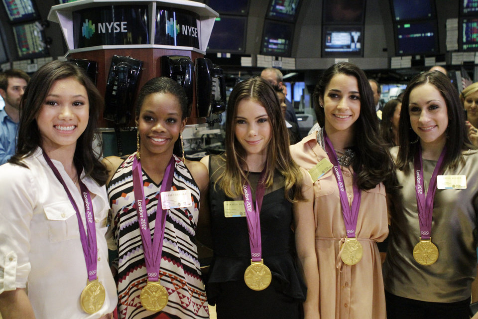 Photo -   From left, Kyla Ross, Gabby Douglas, McKayla Maroney, Aly Raisman, and Jordyn Wieber, members of the United States women's Olympic gymnastics gold medal-winning team, pose for photos on the floor of the New York Stock Exchange, Tuesday, Aug. 14, 2012, in New York. (AP Photo/Alex Katz)
