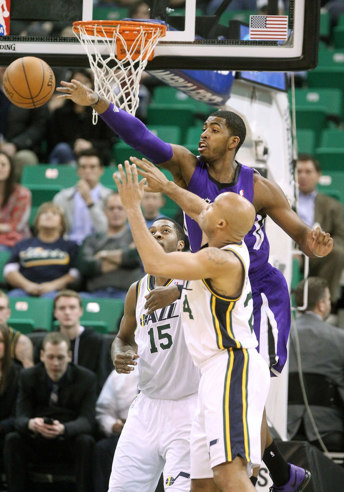 Photo - Sacramento Kings' Jason Thompson, rear, reaches for the ball as Utah Jazz's Derrick Favors (15) and teammate Richard Jefferson, front, look on in the first half of an NBA basketball game, Monday, Jan. 27, 2014, in Salt Lake City. (AP Photo/Rick Bowmer)
