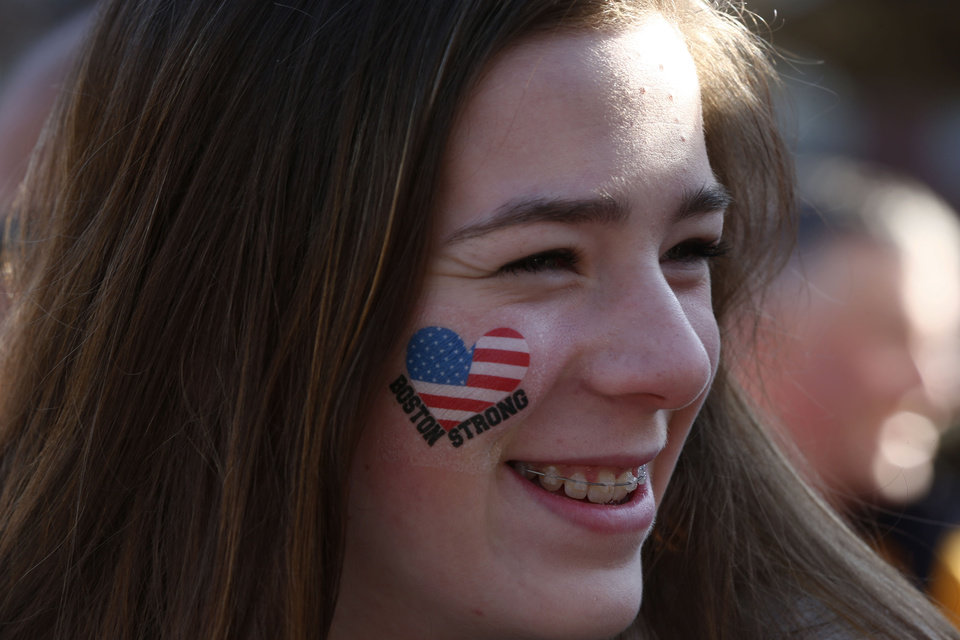 Photo - Sophie Ordman, of Calgary, Alberta, awaits the start of the 118th Boston Marathon Monday, April 21, 2014 in Boston. Her mother is competing in the race. (AP Photo/Matt Rourke)