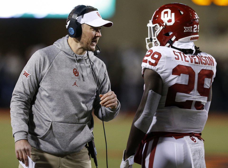 Photo - OU head coach Lincoln Riley talks to Rhamondre Stevenson (29) during the Bedlam college football game between the Oklahoma State Cowboys (OSU) and Oklahoma Sooners (OU) at Boone Pickens Stadium in Stillwater, Okla., Saturday, Nov. 30, 2019. [Nate Billings/The Oklahoman]