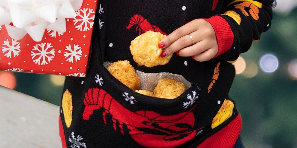 Photo - Red Lobster's new ugly holiday sweater is accented with a heated pocket for those who want to carry around their Cheddar Bay Biscuits.