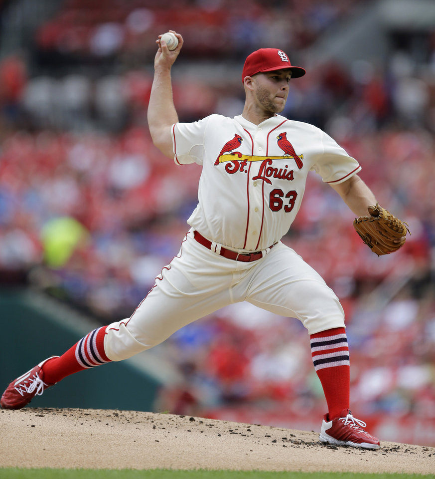 Photo - St. Louis Cardinals starting pitcher Justin Masterson throws during the first inning in the first baseball game of a doubleheader against the Chicago Cubs Saturday, Aug. 30, 2014, in St. Louis. (AP Photo/Jeff Roberson)