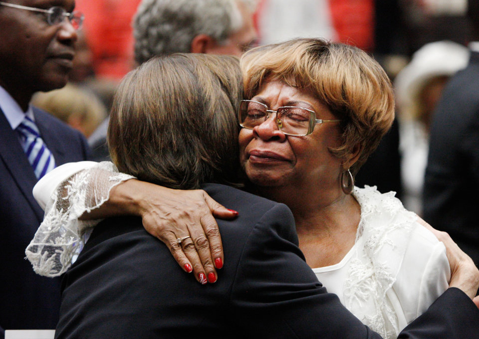 Photo - Daughter Marilyn Hildreth is hugged by Jane Jayroe after the service.  About 2,500 people celebrated the life and legacy of Oklahoma City civil rights pioneer Clara Mae Shepard Luper  during a lively service in the Cox Convention Center that lasted more than three hours, Friday,  June 17, 2011.  Luper died  last week at the age of 88. Photo by Jim Beckel, The Oklahoman