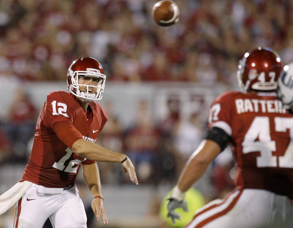 Photo - OU's Landry Jones throws a pass during the second half of the college football game between the University of Oklahoma Sooners (OU) and Utah State University Aggies (USU) at the Gaylord Family-Oklahoma Memorial Stadium on Saturday, Sept. 4, 2010, in Norman, Okla.   Photo by Bryan Terry, The Oklahoman