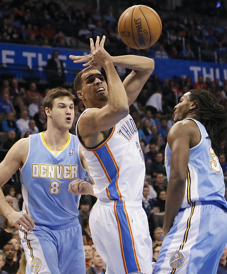 Photo - Oklahoma City's Thabo Sefolosha (2) looses the ball between Denver's Danilo Gallinari (8) and Kenneth Faried (35) during the NBA basketball game between the Oklahoma City Thunder and the Denver Nuggets at the Chesapeake Energy Arena on Wednesday, Jan. 16, 2013, in Oklahoma City, Okla.  Photo by Chris Landsberger, The Oklahoman