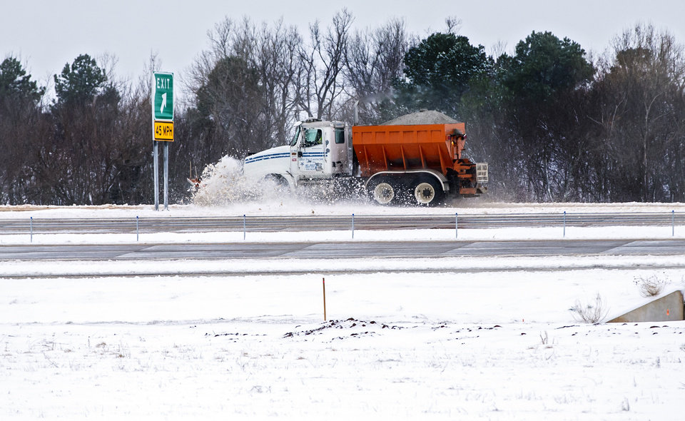 Photo - A sand truck removes snow form the Kilpatrick Turnpike in Oklahoma City, Okla. on Wednesday, Feb. 5, 2020.  [Chris Landsberger/The Oklahoman]