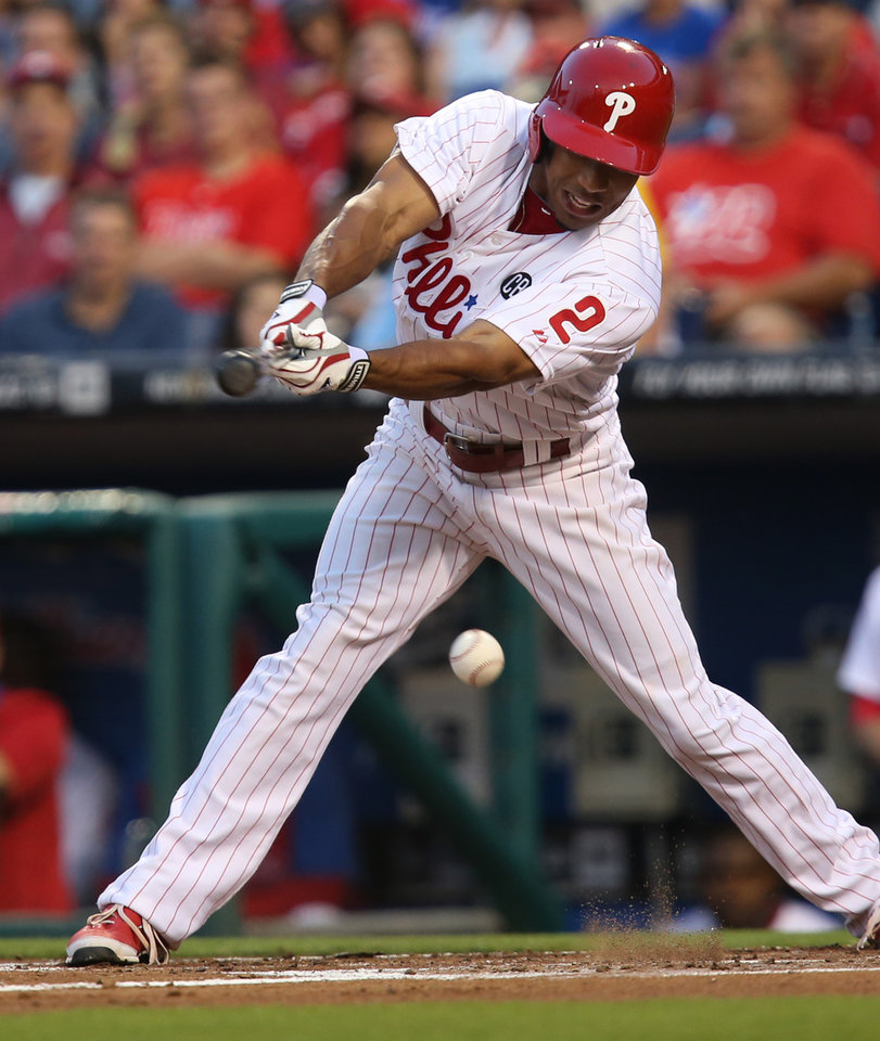 Photo - Philadelphia Phillies Ben Revere connects for a single in the first inning of a baseball game against the Philadelphia Phillies, Friday, Aug. 22, 2014, in Philadelphia. (AP Photo/Laurence Kesterson)