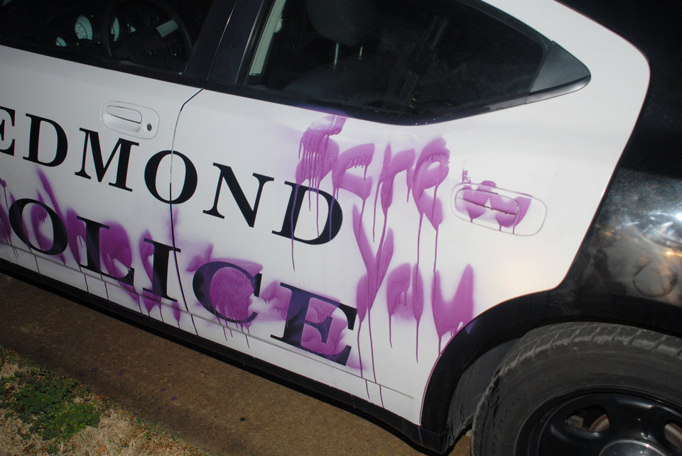 An Edmond police car was hit twice by vandals who left messages on the city-owned vehicle. PHOTO PROVIDED, EDMOND POLICE DEPARTMENT. PROVIDED