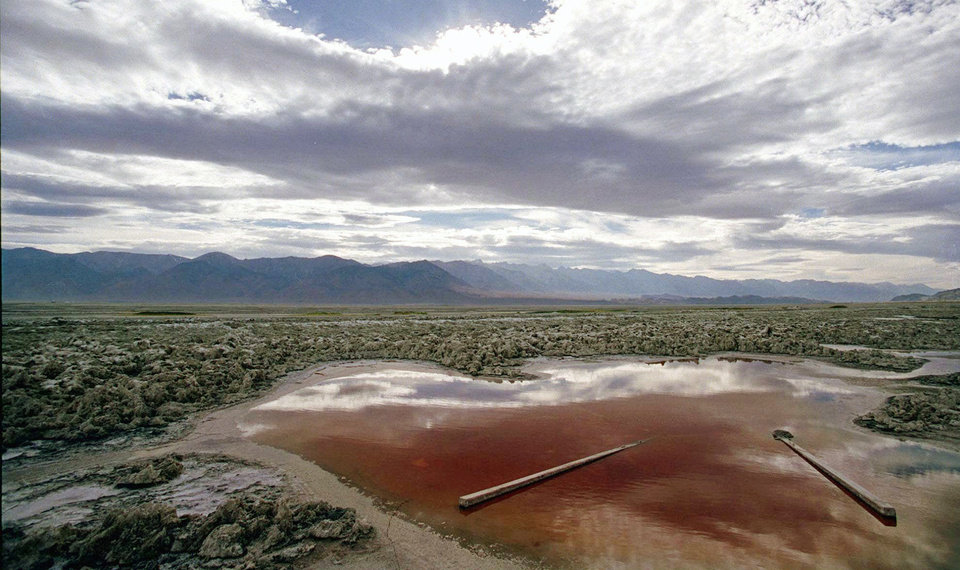 FILE - This July 16, 1997 file photo shows Owens Lake, Calif., about 200 miles north of Los Angeles. The city of Los Angeles sued air regulators Friday, Oct. 12, 2012 over demands to control dust from Owens Lake nearly a century after the exploding metropolis siphoned water to quench its growing thirst. (AP Photo/Damian Dovarganes, File)