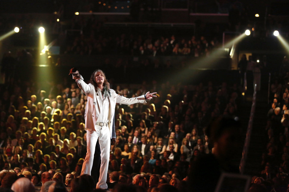 Photo - Presenter Steven Tyler sings a Smokey Robinson song at the 56th annual Grammy Awards at Staples Center on Sunday, Jan. 26, 2014, in Los Angeles. (Photo by Matt Sayles/Invision/AP)