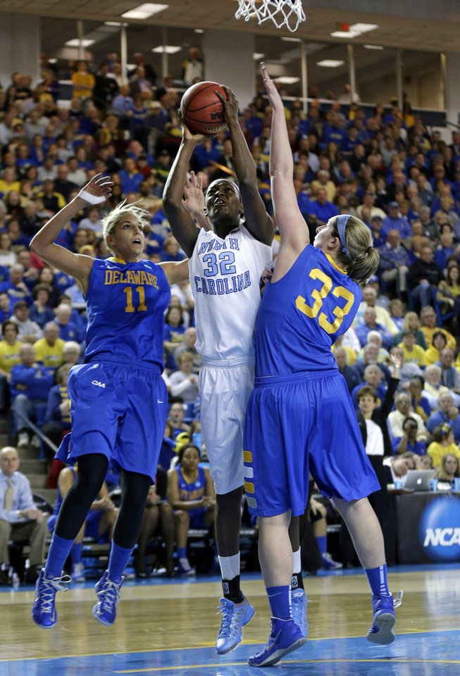 North Carolina center Waltiea Rolle (32) shoots between Delaware guard/forward Elena Delle Donne, left, and center Stephanie Leon during the first half of a second-round game in the women's NCAA college basketball tournament in Newark, Del., Tuesday, March 26, 2013. (AP Photo/Patrick Semansky)