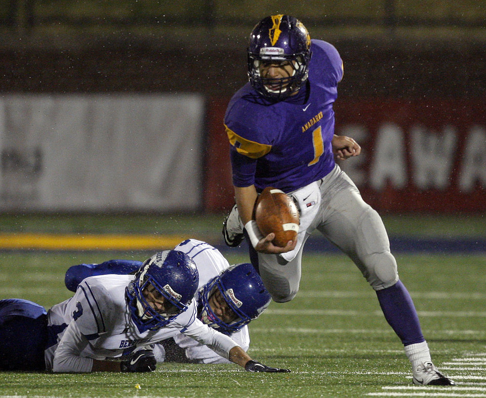 Anadarko's Sheldon Wilson gets by Berryhill's Justin Jackson, left, and Trey Jimenez during the 3A semifinal of high school football championships between Anadarko and Berryhill at Wantland Stadium in Edmond, Okla.,Friday, Dec. 2, 2011.  Photo by Sarah Phipps, The Oklahoman
