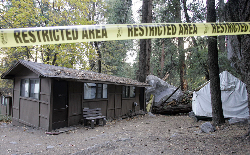 FILE - In this Monday, Oct. 20, 2008 file photo, restriction tape blocks an area at Curry Village in Yosemite National Park, Calif., after a boulder fell during a rock slide. Falling boulders are the single biggest force shaping Yosemite Valley, one of the most popular tourist destinations in the nation�s system of national parks. Now large swaths of popular haunts deemed unsafe are closing as officials acknowledge they knew for more than a decade ago that unsuspecting tourists were being lodged in harm�s way. On Thursday, June 14, 2012, the National Park Service will announce that potential danger from the unstable 3,000-foot-tall slab of granite known as Glacier Point, a picturesque promontory that for decades has provided a dramatic backdrop to park entertainment events, will leave uninhabitable large parts of Yosemite Valley�s most popular lodging areas. (AP Photo/Paul Sakuma)