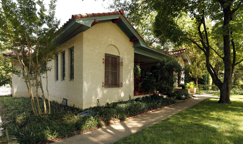 Photo -  Michael Brinkley and Lynda Donley received a Citation of Merit for rehabilitation work on their home at 639 S Lahoma in Norman's Chautauqua Historic District. The Spanish Mission Revival-style home was built in 1921.    STEVE SISNEY -  THE OKLAHOMAN