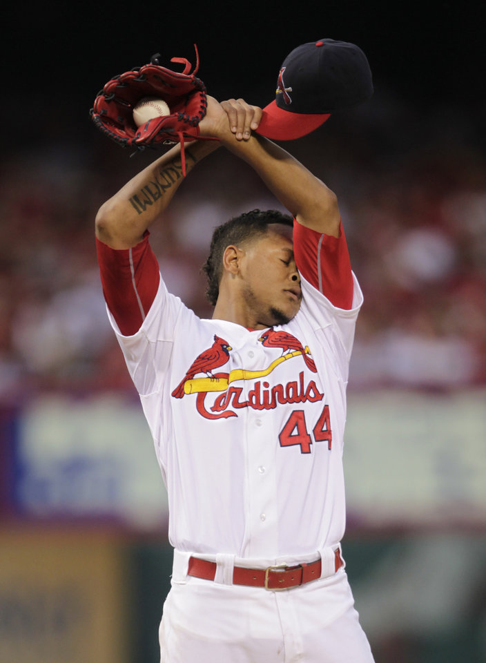 Photo - St. Louis Cardinals starting pitcher Carlos Martinez (44) regroups after giving up back to back RBI's in the third inning of a baseball game against the Los Angeles Dodgers, Sunday, July 20, 2014 in St. Louis.  (AP Photo/Tom Gannam)