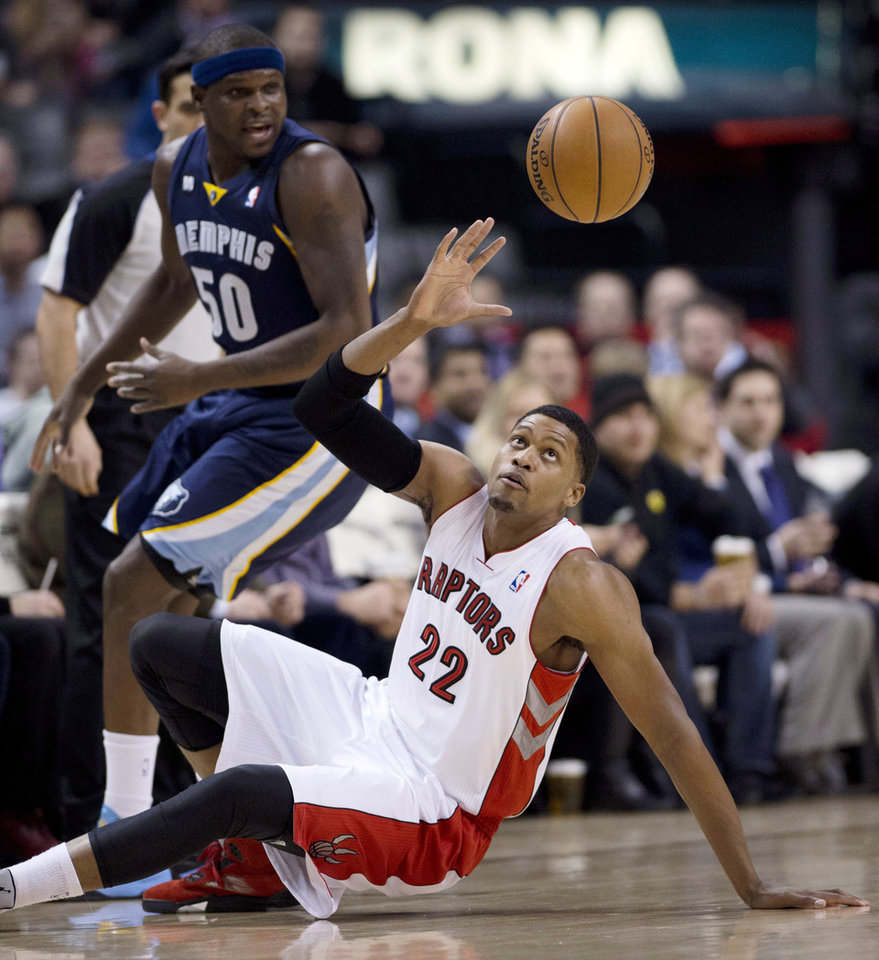 Memphis Grizzlies forward Zach Randolph (50) watches as Toronto Raptors forward Rudy Gay (22) picks up a loose ball during the first half of an NBA basketball game, Wednesday, Feb. 20, 2013, in Toronto. (AP Photo/The Canadian Press, Frank Gunn)