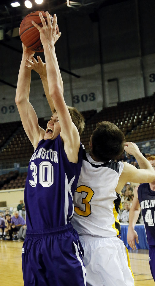 Burlington\'s Kyle Ellerbeck (30) grabs a rebound over Arnett\'s Trevor Bryant (3) during a Class B Boys first-round game of the state high school basketball tournament between Burlington and Arnett at Jim Norick Arena, The Big House, on State Fair Park in Oklahoma City, Thursday, Feb. 28, 2013. Arnett won, 56-32. Photo by Nate Billings, The Oklahoman