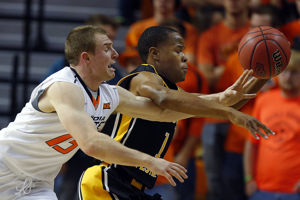 Photo - Oklahoma State's Phil Forte III (13) defends against Missouri Western's  Cortrez Colbert during the men's college between Oklahoma State University and Missouri Western at Gallagher-Iba Arena in Stillwater, Okla., Saturday, Nov. 8, 2014.  Photo by Sarah Phipps, The Oklahoman